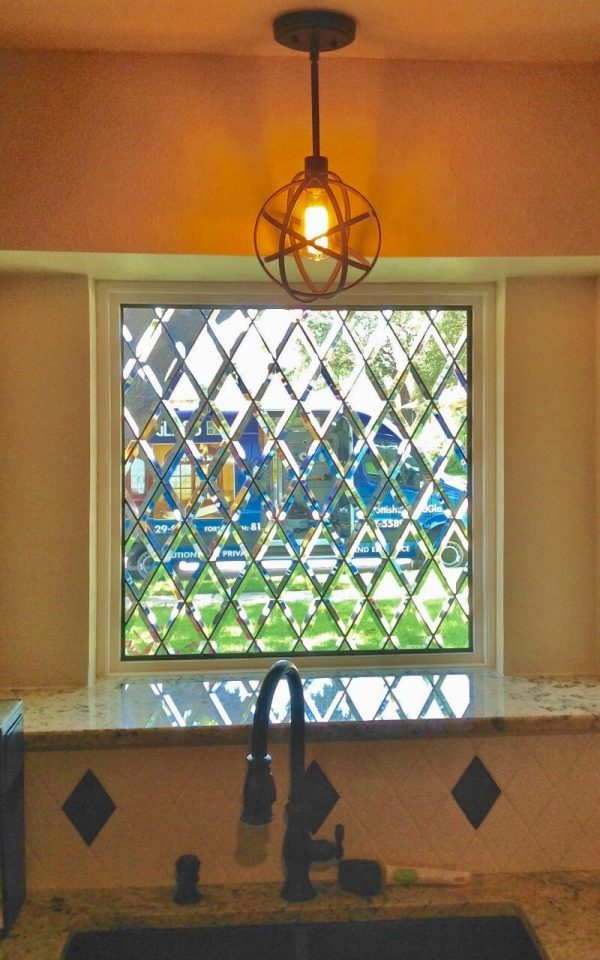 3 great ideas for remodeling the kitchen of your austin for Stained glass kitchen windows